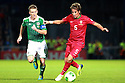 Portugal's Fabio Coentrao tackles Northern Ireland's Steven Davis during a World Cup Qualifier in Belfast, Friday September 6th, 2013.  Photo/Paul McErlane