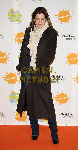 "DR. LINDA PAPADOPOULOS .At the ""Spongebob Squarepants - The Sponge who could Fly"" Gala performance at the Hammersmith Apollo, London, England. .March 5th 2009 .ull length coat long cream scarf brown coat beige jeans .CAP/CAN.©Can Nguyen/Capital Pictures."