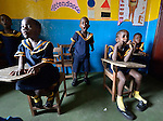 Children respond enthusiastically to their teacher's questions during class in a day care center in Monrovia, Liberia, sponsored by United Methodist Women.