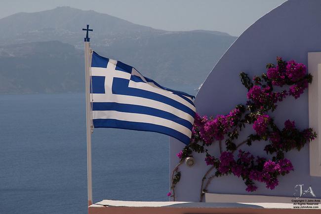 Greek Flag on a Pastel Building