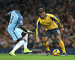 Bacary Sagna of Manchester City tussles with Alex Oxlade-Chamberlain of Arsenal during the English Premier League match at the Etihad Stadium, Manchester. Picture date: December 18th, 2016. Picture credit should read: Simon Bellis/Sportimage