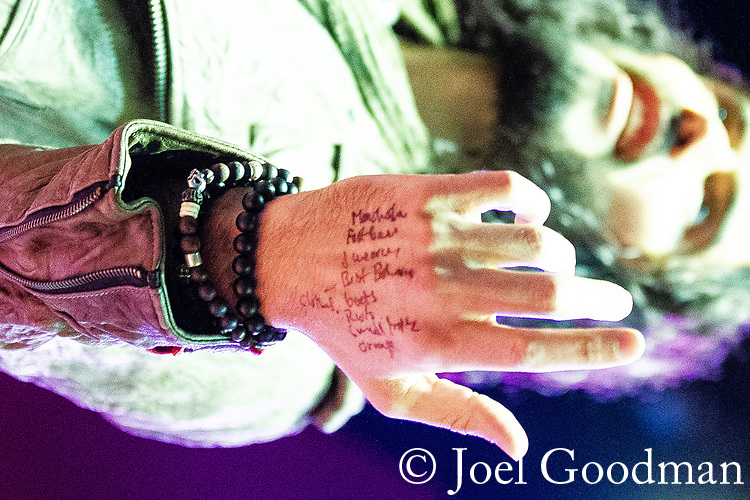 © Joel Goodman - 07973 332324 . 16/06/2012 . Manchester , UK . RUSSELL BRAND 's notes on the back of his hand at the Stand Up and Be the Change youth event , hosted by the Dalai Lama during a 10 day UK tour , at the Manchester Arena . Photo credit : Joel Goodman