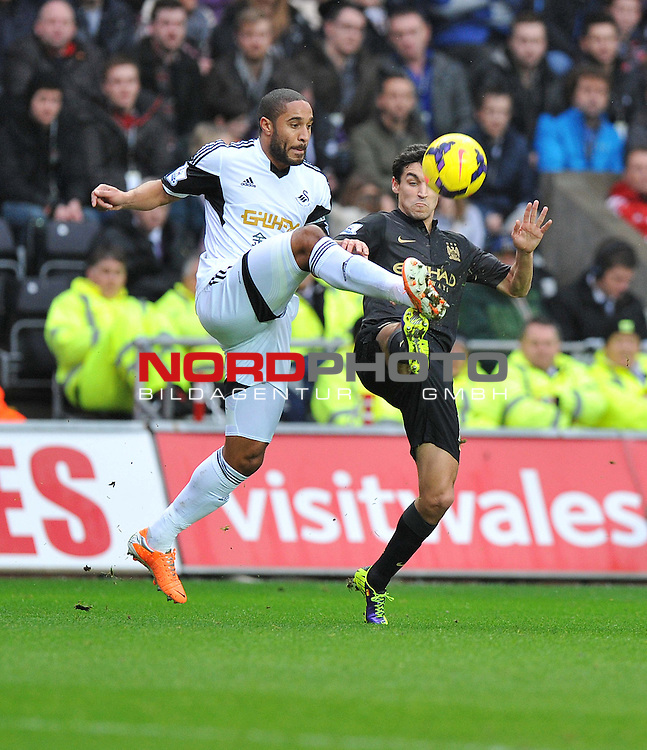 Manchester City's Jes&uacute;s Navas battles for a high ball with Swansea City's Ashley Williams -  01/01/2014 - SPORT - FOOTBALL - Liberty Stadium - Swansea - Swansea City v Manchester City - Barclays Premier League<br /> Foto nph / Meredith<br /> <br /> ***** OUT OF UK *****