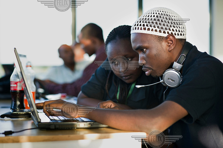 Young people use a computer at iHup, Nairobi's innovation hub for the technology community. It's an open space for technologists, investors and tech companies.