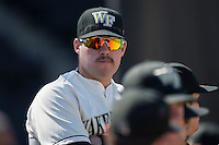 Parker Johnson (27) of the Wake Forest Demon Deacons watches the action from the dugout during the game against the Virginia Tech Hokies at Wake Forest Baseball Park on March 7, 2015 in Winston-Salem, North Carolina.  The Hokies defeated the Demon Deacons 12-7 in game one of a double-header.   (Brian Westerholt/Four Seam Images)
