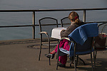Woman working at table,Friedrichshafen on Lake Bodensee, Germany,