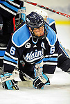 30 October 2010: University of Maine Black Bears' defenseman Jeff Dimmen, a Senior from Colorado Springs, CO, looks up from the ice during a game against the University of Vermont Catamounts at Gutterson Fieldhouse in Burlington, Vermont. The Black Bears defeated the Catamounts 3-2 in sudden death overtime. Mandatory Credit: Ed Wolfstein Photo