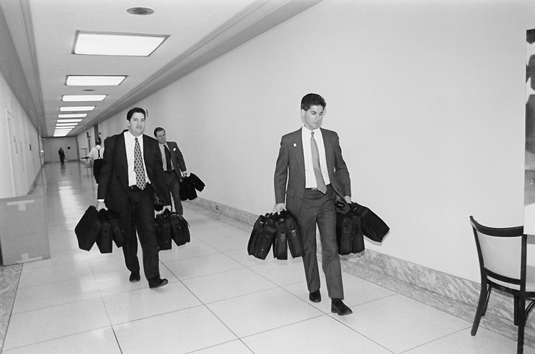 Loaded down with laptops, staffers make the delivery to the service centers in Rayburn House Office Building cafeteria connected to 'Rest Shop' for new members on Nov. 29, 1994. (Photo by Maureen Keating/CQ Roll Call via Getty Images)