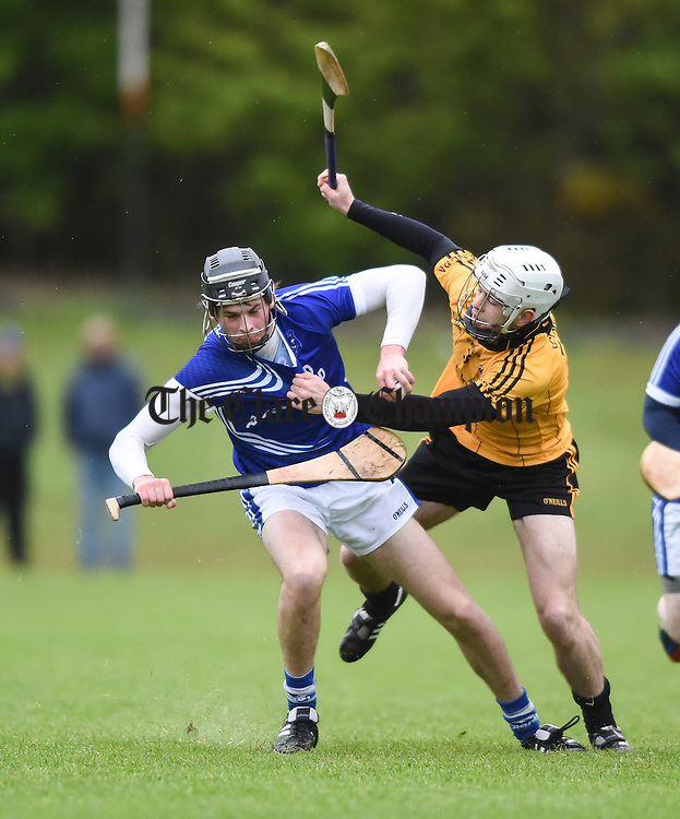 Michael Danagher of Cratloe in action against Gareth Kennedy of Clonlara during their Clare Champion Cup game at Cratloe. Photograph by John Kelly.