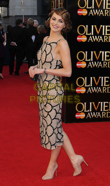 Kara Tointon.The Olivier Awards 2012, Royal Opera House, Covent Garden, London, England..April 15th, 2012.full length print dress black beige side sleeveless .CAP/CAN.©Can Nguyen/Capital Pictures.