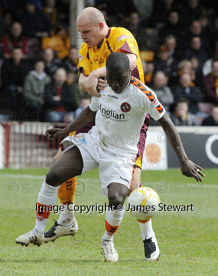 26/04/2008   Collect Pic: James Stewart.File Name : sct_jspa17_motherwell_v_dundee_utd.MORGARO GOMIS HOLDS OFF ROBERT MALCOLM.James Stewart Photo Agency 19 Carronlea Drive, Falkirk. FK2 8DN      Vat Reg No. 607 6932 25.Studio      : +44 (0)1324 611191 .Mobile      : +44 (0)7721 416997.E-mail  :  jim@jspa.co.uk.If you require further information then contact Jim Stewart on any of the numbers above........
