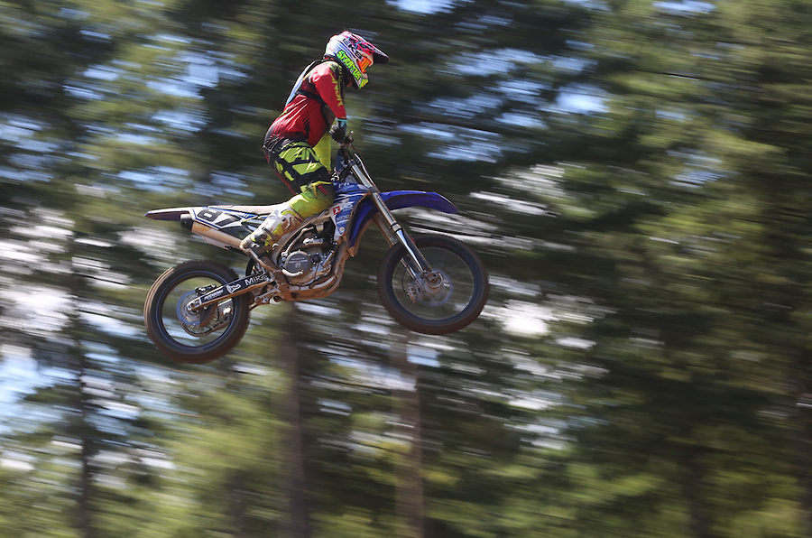 PJ Larsen  of Murrieta, California (or Austin <br /> Politelli) flies through the air as he takes part in the 450cc race in the Washougal MX National in Washougal Saturday July 23, 2016. D(Photo by Natalie Behring/ for the The Columbian)