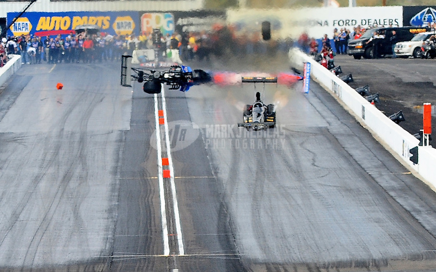 Feb. 21, 2010; Chandler, AZ, USA; NHRA top fuel dragster driver Antron Brown crashes during the Arizona Nationals at Firebird International Raceway. A tire from his car flew over the trackside wall and into a spectator area causing serious injuries. Mandatory Credit: Mark J. Rebilas-