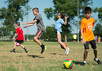 NWA Democrat-Gazette/BEN GOFF @NWABENGOFF<br /> Campers race Tuesday, June 5, 2018, during Bentonville's Camp Memorial at Memorial Park. The five-day camp session for ages 8-12 is part of Bentonville Parks and Recreation's Camp Bentonville program. Campers split into teams to compete in a variety of summer sports and activities each day, including soccer, basketball, scavenger hunts and swimming.