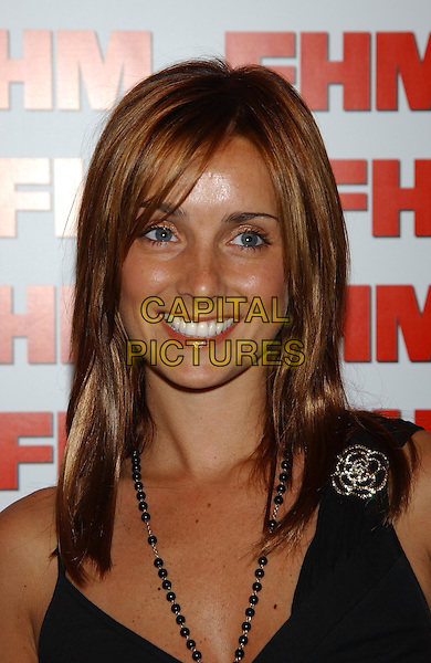LOUISE REDKNAPP - LOUISE NURDING.FHM 100 Sexiest Party 2003.Aldwych tube station.sales@capitalpictures.com.www.capitalpictures.com.©Capital Pictures.brooch