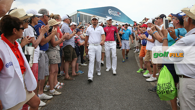 Heroes welcome for Victor Dubuisson (FRA) &amp; Martin Kaymer (GER) as they walk down to the first tee during the Final Round of the 2015 Alstom Open de France, played at Le Golf National, Saint-Quentin-En-Yvelines, Paris, France. /05/07/2015/. Picture: Golffile | David Lloyd<br /> <br /> All photos usage must carry mandatory copyright credit (&copy; Golffile | David Lloyd)