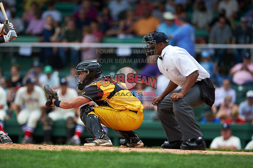Jacksonville Suns catcher Sharif Othman (6) and umpire J.J. January during the 20th Annual Rickwood Classic Game against the Birmingham Barons on May 27, 2015 at Rickwood Field in Birmingham, Alabama.  Jacksonville defeated Birmingham by the score of 8-2 at the countries oldest ballpark, Rickwood opened in 1910 and has been most notably the home of the Birmingham Barons of the Southern League and Birmingham Black Barons of the Negro League.  (Mike Janes/Four Seam Images)