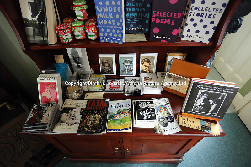 Swansea, UK. Saturday 25 October 2014<br /> Pictured: Books, leaflets and other items on a bookcase at the house where Dylan Thomas was born.<br /> Re: Dylan Thomas birthday centenary celebrations at his birthplace, 5 Cwmdonkin Drive, Swansea, south Wales.
