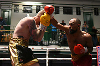 Robert Asagba (red shorts) defeats Dale Arrowsmith during a Boxing Show at York Hall on 7th September 2019