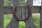Lucky horseshoe on wooden gate