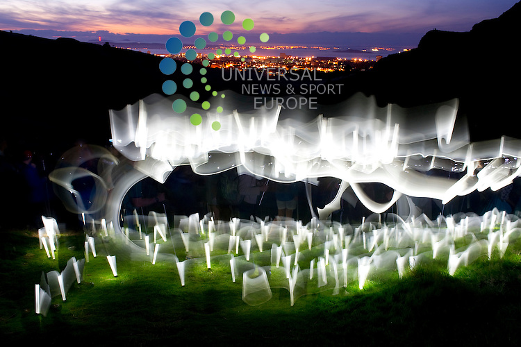 Public art meets sporting endeavour as runners and walkers light up Arthur's Seat in Edinburgh for the NVA's Speed of Light performance as part of the Edinburgh International Festival 2012, 9th August, 2012..Picture:Scott Taylor Universal News And Sport (Europe) .All pictures must be credited to www.universalnewsandsport.com. (Office)0844 884 51 22.