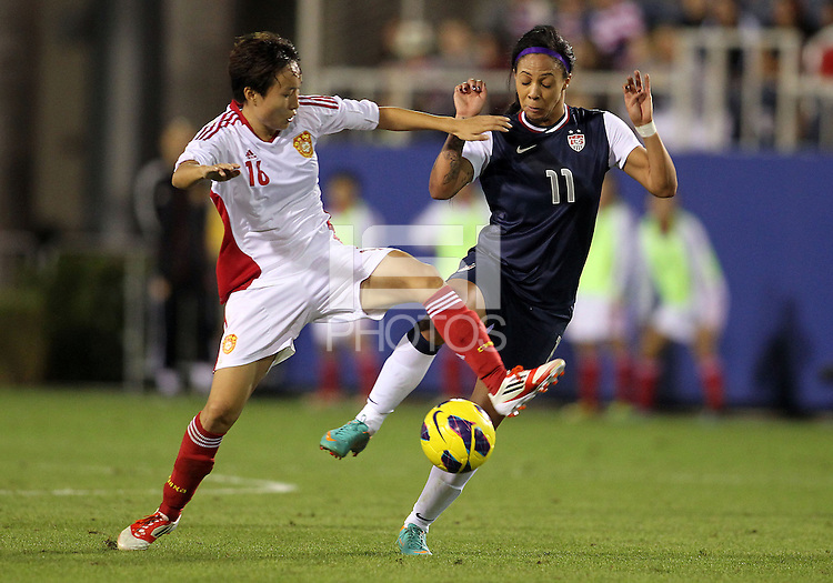 BOCA RATON, FL - DECEMBER 15, 2012: Sydney Leroux (11) of the USA WNT is tackled by Wang Chen (16) of China WNT during an international friendly match at FAU Stadium, in Boca Raton, Florida, on Saturday, December 15, 2012. USA won 4-1.