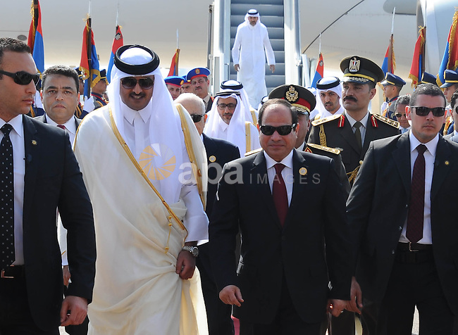 Egypt's President Abdel Fattah al-Sisi (L) receives Qatar Sheikh Tamim bin Hamad al Thani upon his arrival ahead of the Arab Summit in Sharm el-Sheikh, in the South Sinai governorate, south of Cairo, March 28, 2015. Arab League heads of state will hold a two-day summit to discuss a range of conflicts in the region, including Yemen and Libya, as well as the threat posed by Islamic State militants. Egyptian Presidency