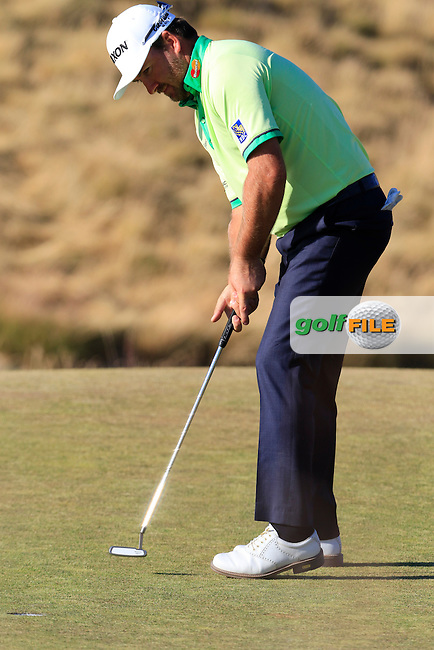 Graeme McDOWELL (NIR) sinks his birdie putt on the 15th green during Friday's Round 2 of the 2015 U.S. Open 115th National Championship held at Chambers Bay, Seattle, Washington, USA. 6/20/2015.<br /> Picture: Golffile | Eoin Clarke<br /> <br /> <br /> <br /> <br /> All photo usage must carry mandatory copyright credit (&copy; Golffile | Eoin Clarke)