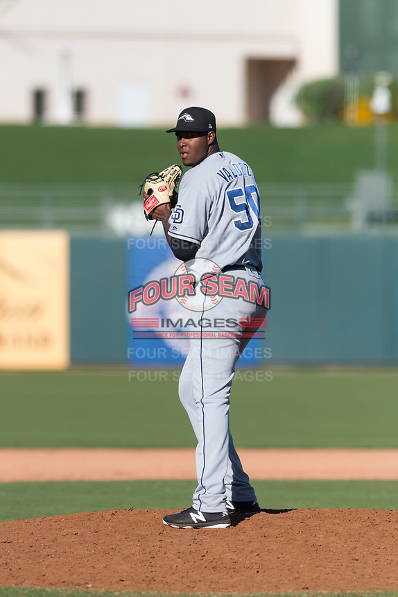 Peoria Javelinas relief pitcher Dauris Valdez (50), of the San Diego Padres organization, gets ready to deliver a pitch during an Arizona Fall League game against the Surprise Saguaros at Surprise Stadium on October 17, 2018 in Surprise, Arizona. (Zachary Lucy/Four Seam Images)