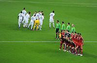 FUSSBALL   CHAMPIONS LEAGUE   SAISON 2011/2012  Achtelfinale Rueckspiel 13.03.2012 FC Bayern Muenchen - FC Basel  Mannschaftsbild FC Bayern Muenchen (re) und FC Basler-Unordnung