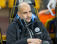 27th December 2019; Molineux Stadium, Wolverhampton, West Midlands, England; English Premier League, Wolverhampton Wanderers versus Manchester City; Manchester City Manager Pep Guardiola watches his players on the field during the warm up  - Strictly Editorial Use Only. No use with unauthorized audio, video, data, fixture lists, club/league logos or 'live' services. Online in-match use limited to 120 images, no video emulation. No use in betting, games or single club/league/player publications