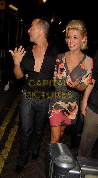 JULIEN MACDONALD & TARA REID.Outside 24 Club in London, England,.September 22nd 2007..half 3/4 length grey pink orange sequined print patterned dress sheer see through funny.CAP/SW.©Capital Pictures.