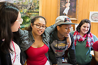 Cynthia Tim, 20, (second from left) talks with students at a Lunar New Year celebration at Middlesex Community College's Asian American Connections Center on Thurs., Feb. 15, 2018. Tim is a Cambodian-American and a second year student at Middlesex Community College studying Business. The Asian American Connections Center was established at the school using a federal grant in 2016 and serves as a focal point for the Asian community at the school, predominantly Cambodian, to gather, socialize, study, and otherwise take part in student life.