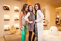 Store Buyers Nicole Erickson, Hanna Fouts and Lauren Wilson model during Fashion's Night Out at Marissa Collections on Third Street South, Naples, Florida, USA, Sept. 8, 2011. Photo by Debi Pittman Wilkey.
