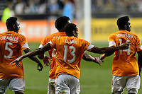 Ricardo Clark (13) of the Houston Dynamo celebrates scoring with teammates. The Houston Dynamo defeated the Philadelphia Union 1-0 during a Major League Soccer (MLS) match at PPL Park in Chester, PA, on September 14, 2013.