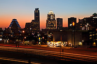 Dusk falls on the majestic Austin Skyline as traffic streaks across the downtown I-35 Bridge.