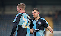 Matt Bloomfield of Wycombe Wanderers & Jason McCarthy of Wycombe Wanderers on the final whistle during the Sky Bet League 2 match between Wycombe Wanderers and Stevenage at Adams Park, High Wycombe, England on 12 March 2016. Photo by Andy Rowland/PRiME Media Images.