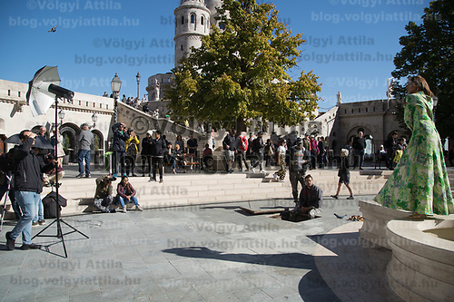 Tourists watch a fashion photoshoot near Budapest's landmark Fisherman's Bastion on World Tourism Day in Budapest, Hungary on Sept. 27, 2018. ATTILA VOLGYI