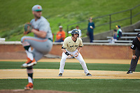 Shane Muntz (11) of the Wake Forest Demon Deacons takes his lead off of first base against the Miami Hurricanes at David F. Couch Ballpark on May 11, 2019 in  Winston-Salem, North Carolina. The Hurricanes defeated the Demon Deacons 8-4. (Brian Westerholt/Four Seam Images)