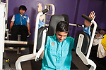 Education High School physical education elective weight lifting boys using exercise equipment