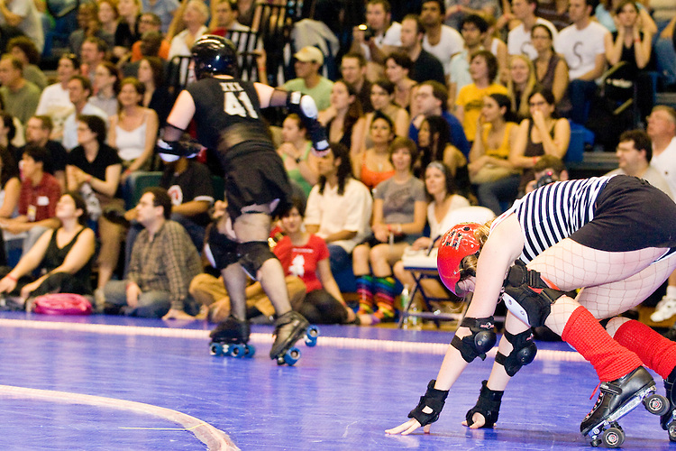 The Queens of Pain and the Brooklyn Bombshells clash at a Gotham Girls Roller Derby bout in New York City on June 2, 2006.