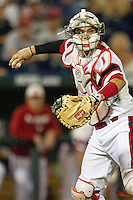 North Carolina State catcher Brett Austin (11) makes a throw to first base against the UCLA Bruins during Game 8 of the 2013 Men's College World Series on June 18, 2013 at TD Ameritrade Park in Omaha, Nebraska. The Bruins defeated the Wolfpack 2-1, eliminating North Carolina State from the tournament. (Andrew Woolley/Four Seam Images)