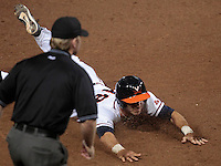 Virginia catcher Nate Irving (18) slides safely into third base during the game against Arkansas Saturday night at Davenport Field in Charlottesville, VA. Photo/The Daily Progress/Andrew Shurtleff