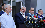 "Hamas Chief Ismail Haniyeh speaks to the press upon his arrival on the Palestinian side of the Rafah border crossing, in the southern Gaza Strip on September 19, 2017. Haniyeh said on Tuesday evening that his movement is ready to receive the Palestinian Unity Government in Gaza during a press conference held immediately after returning to the Gaza Strip from Cairo, he said: ""To show Hamas' seriousness to bring about reconciliation, we invite the unity government to come and assume its duties in Gaza unimpeded."". Photo by Yasser Qudih"