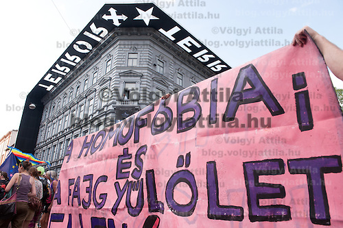 "Participants of the Gay Pride Parade march in front of House of Terror Museum with a banner saying ""Homofobia and racism is bad"" while far-right anti-protesters yell at them in Budapest, Hungary on June 18, 2011. ATTILA VOLGYI"