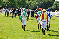Jockeys enter the parade ring to meet their owners and trainers during Father's Day Racing at Salisbury Racecourse on 18th June 2017