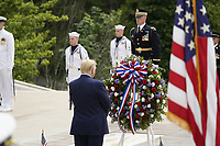 United States President Donald J Trump commemorates Memorial Day by participating in a Wreath Laying ceremony the Tomb of the Unknown Soldiers at Arlington National Cemetery in Arlington, Virginia on Monday, May 25, 2020.<br /> Credit: Chris Kleponis / Pool via CNP/AdMedia