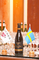 Bottle of Mas La Plana and Swedish and Torres flags. Torres Penedes Catalonia Spain