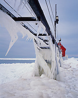 Grand haven State Park, MI:  Grand Haven Lighthouse and ice coated catwalk over the frozen surface of Lake Michigan