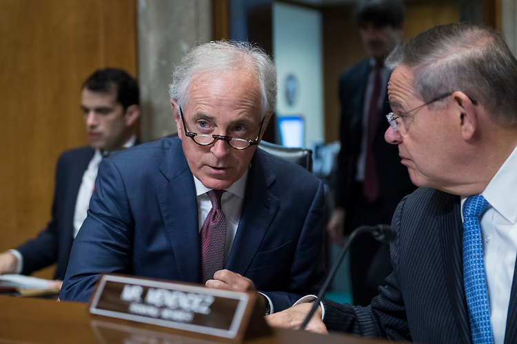 UNITED STATES - AUGUST 01: Chairman Bob Corker, R-Tenn., left, and ranking member Sen. Bob Menendez, D-N.J., talk during a Senate Foreign Relations Committee nominations hearing in Dirksen Building on August 1, 2018. (Photo By Tom Williams/CQ Roll Call)